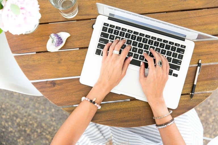 woman editing a travel blog to promote tourism business